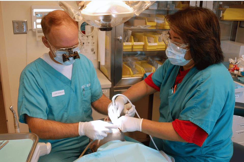 dentists treating a patient