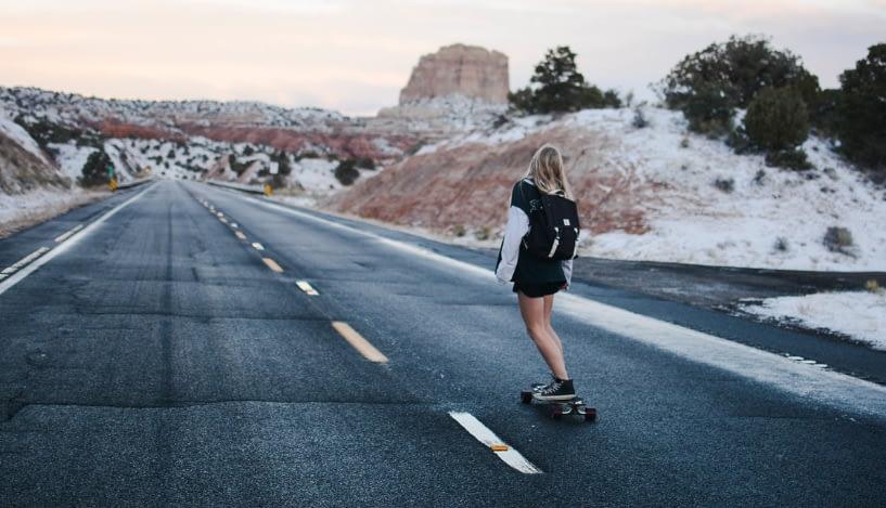 woman on a longboard