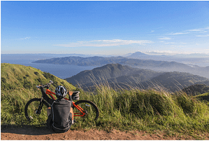 a man in the mountains with a bike